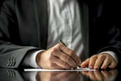 25095774 - conceptual image of a man signing a last will and testament document.